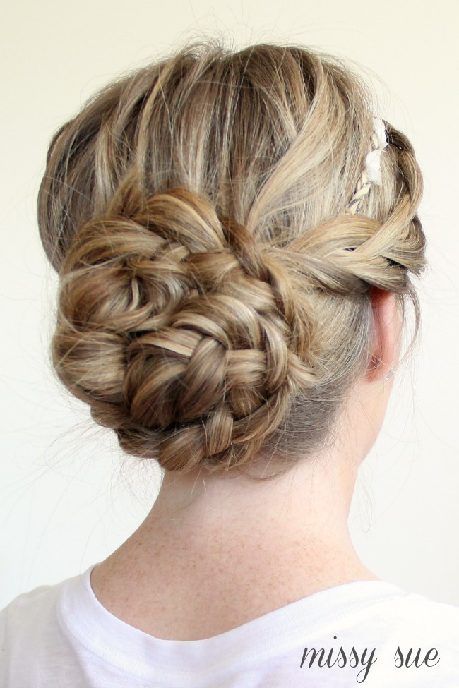 Braided Updo And Flower Crown Hairstyle